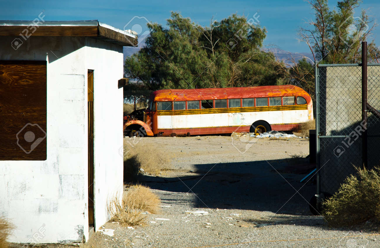 Photograph of a vintage yellow school bus now turned rusty with age. Stock Photo - 11507282