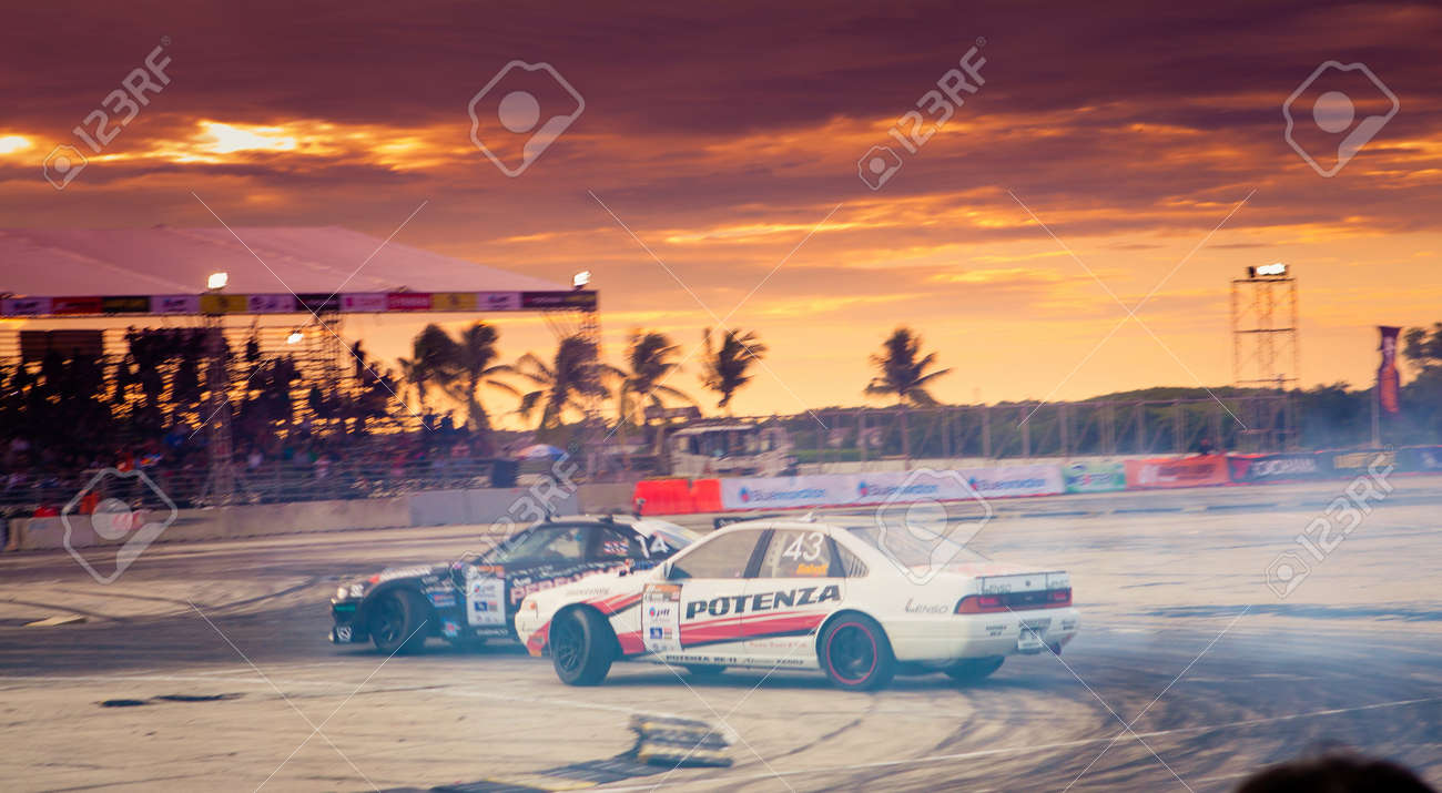NONTHABURI THAILAND-JUNE 30 : Wide angle view of drifting track with beautiful twiligt sky as background in D1 Grand Prix Series Thailand Professional Drift on June 30, 2013 in Nonthaburi, Thailand. Stock Photo - 24675389