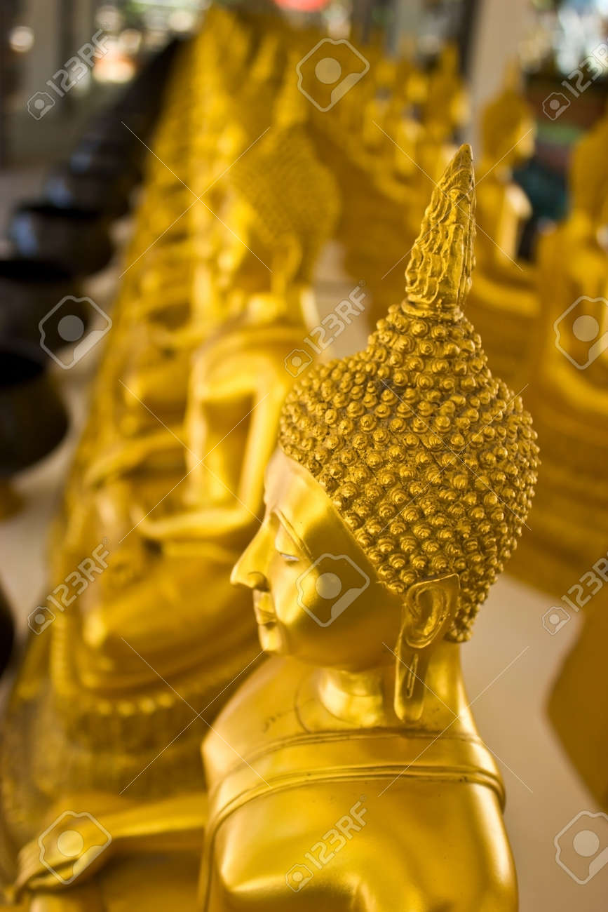 Seated Buddha at the temple of Wat Nakhon Sawan, Thailand (Focus was the first Buddha). Stock Photo - 12017989