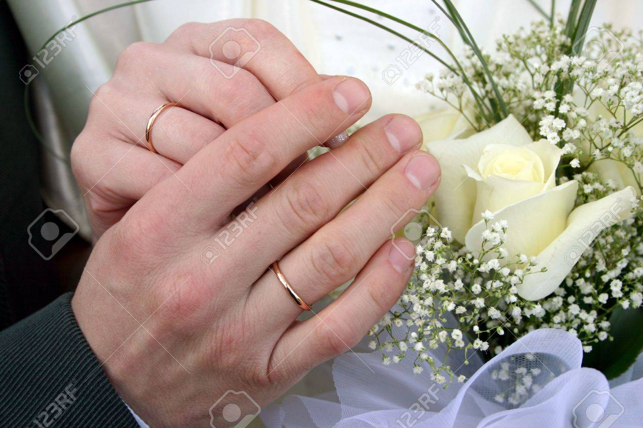 Two Rings On Fingers Newly Married, A Bouquet Of Yellow Roses ...