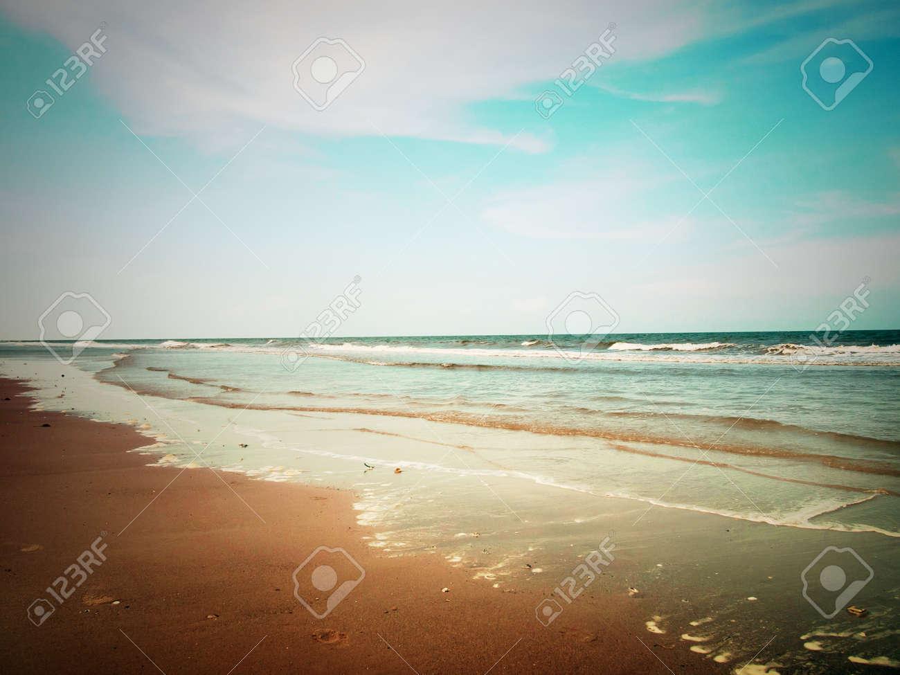 beach and cloudy sky, retro style Stock Photo - 13357866
