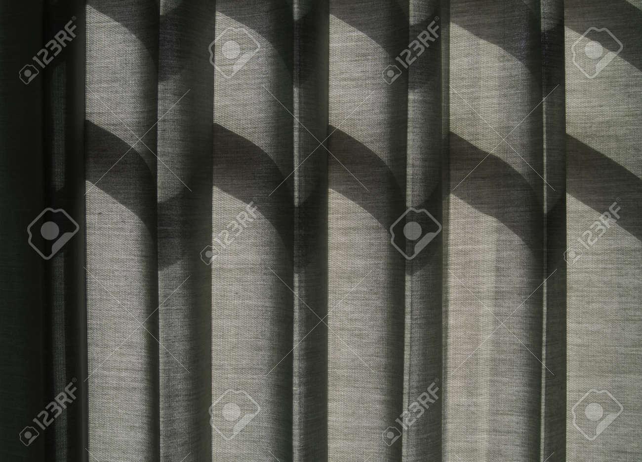 Shade on Grey Curtain, Sunlight Through a Window Stock Photo - 14414340