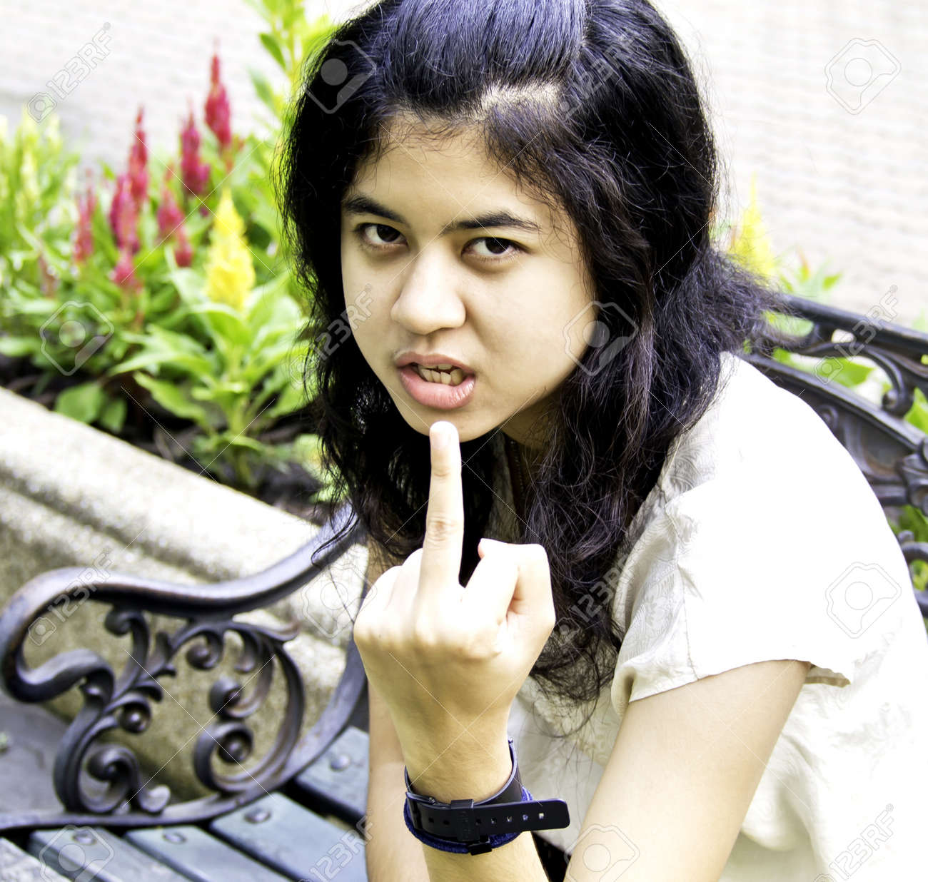 Woman showing middle finger Stock Photo - 15560854