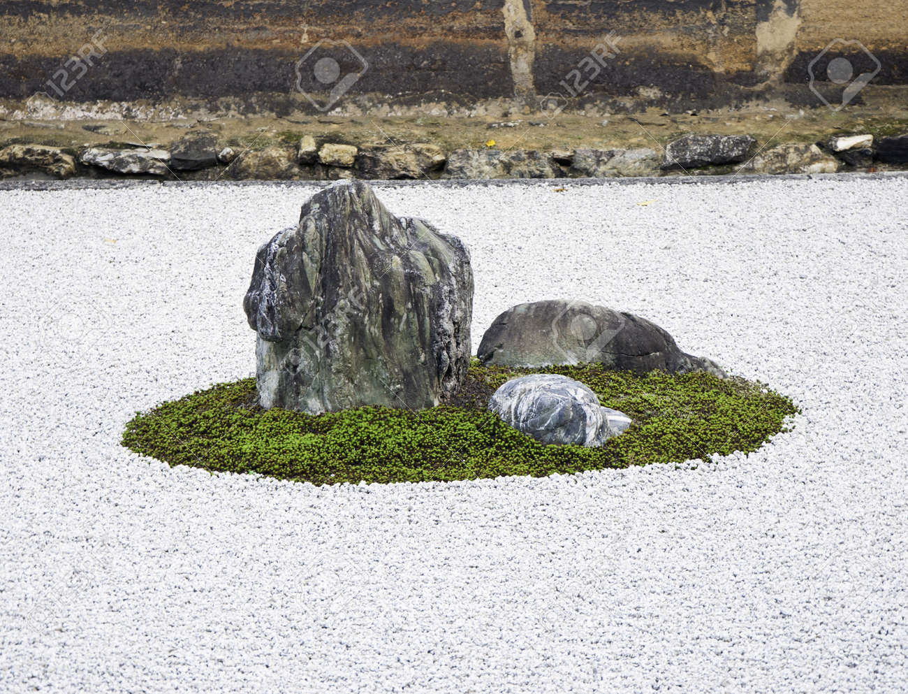 stock photo zen rock garden in ryoanji temple in a garden fifteen stones on white gravel kyoto japan - Zen Rock Garden