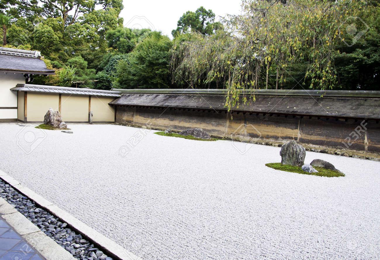 A Zen Rock Garden In Ryoanji Temple In A Garden Fifteen Stones