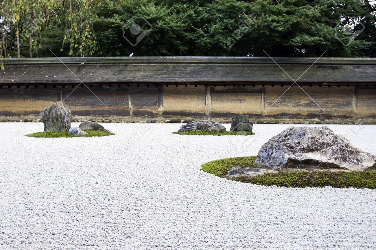Zen rock garden in ryoanji temple a garden fifteen stones stock stock photo zen rock garden in ryoanji temple a garden fifteen stones on white gravel kyotojapan workwithnaturefo