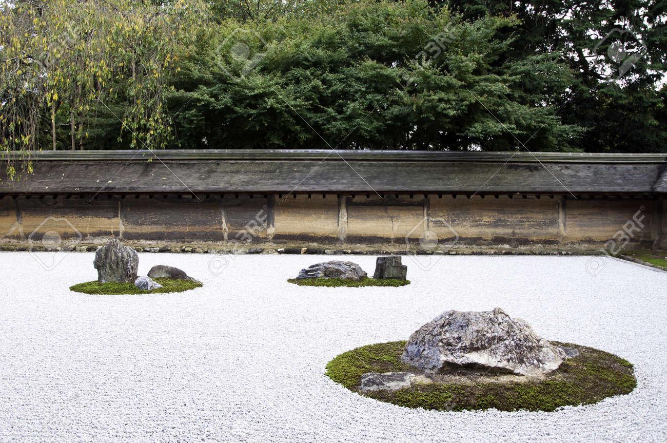 a zen rock garden in ryoanji templein a garden fifteen stones on white gravel - Zen Rock Garden