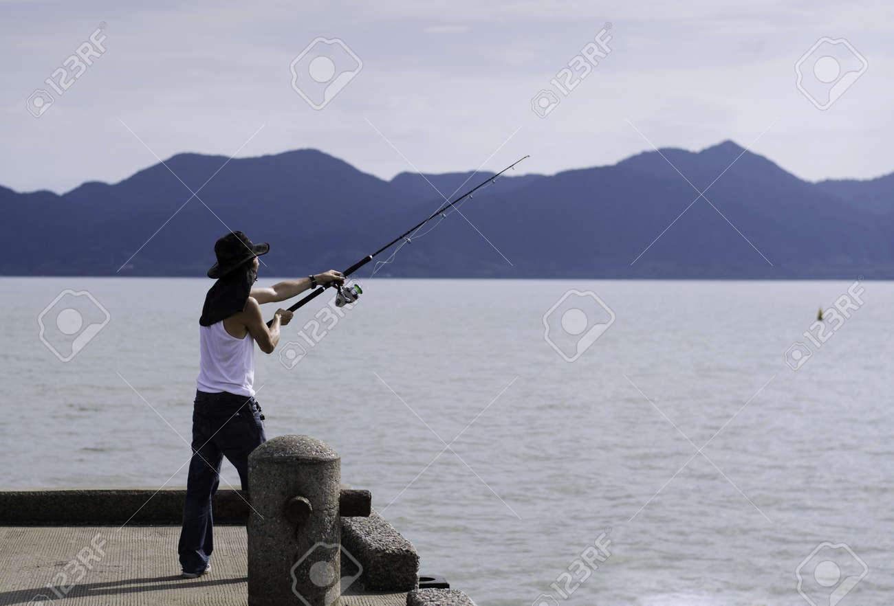 Fisherman fishing trolling in the sea, Chonburi, Thailand Stock Photo - 20617142