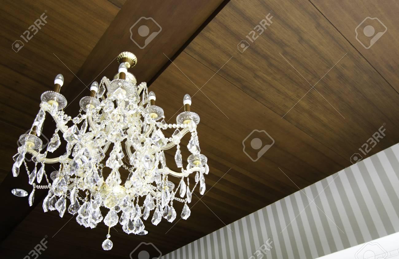Beautiful crystal chandelier hang on wood ceiling