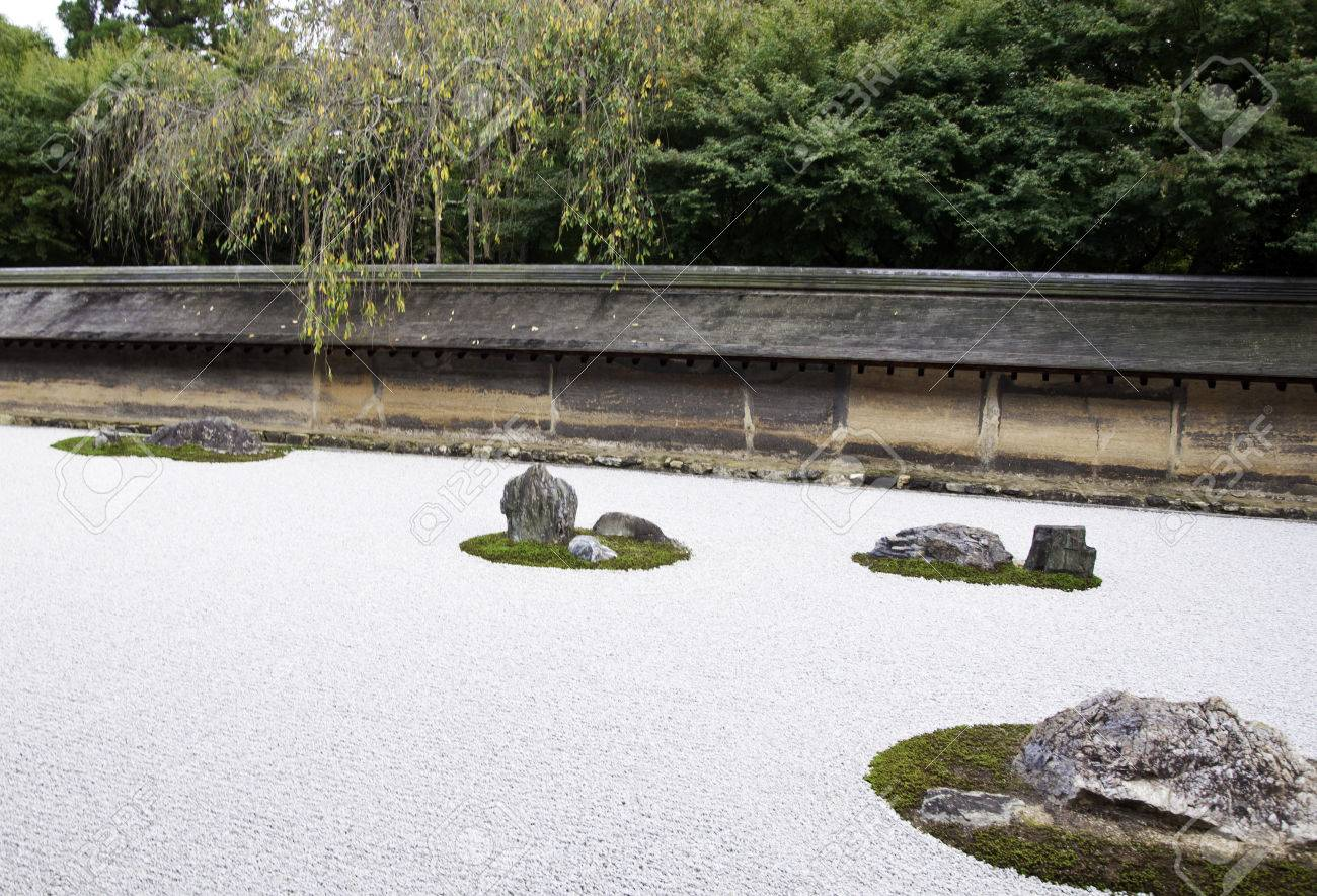 Famous Zen Garden Of The Ryoan Ji Temple In Kyoto Japan Stock Photo