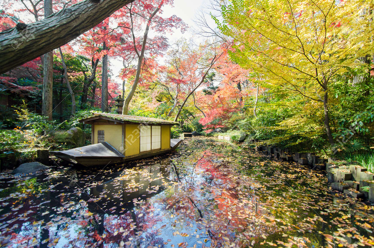 Traditional japanese gardens - Traditional Boat In Japanese Garden In Autumn Tokyo Japan Stock Photo 27831292