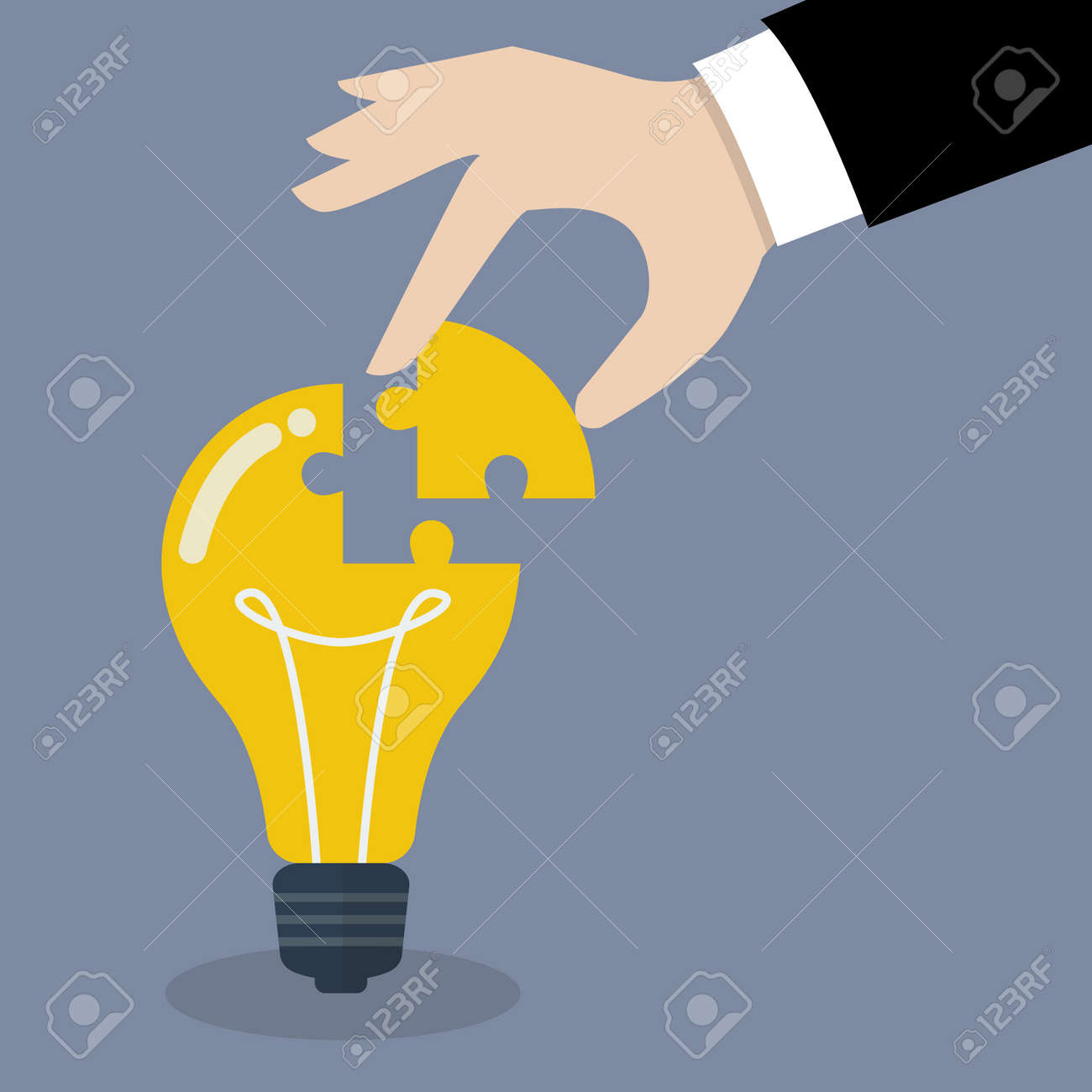 Hand inserts the missing puzzle in lightbulb. Business idea concept - 43529415