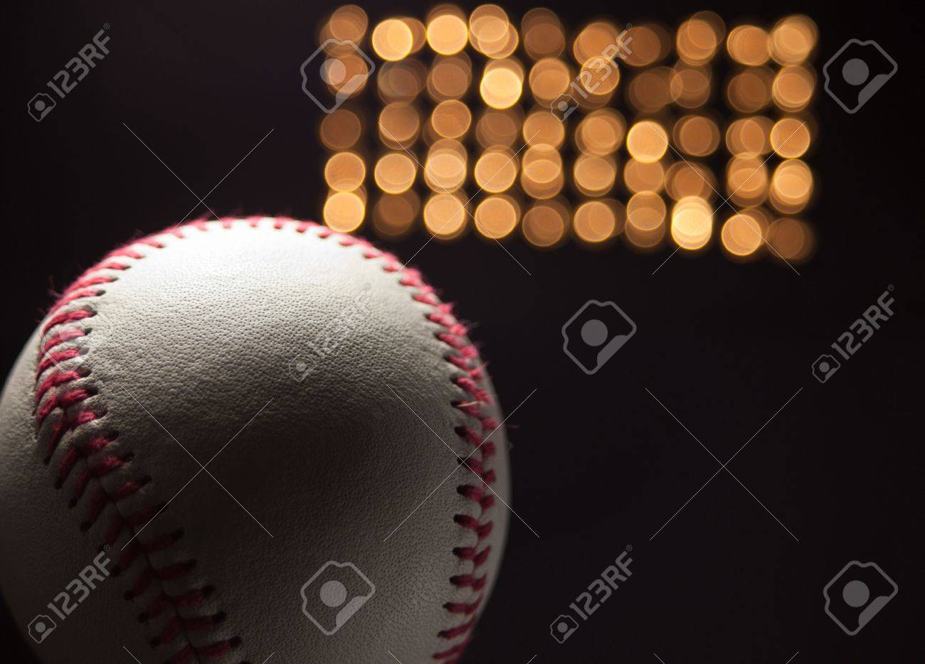 A close up of a new baseball at night with stadium lights in the back ground. Stock Photo - 5100111