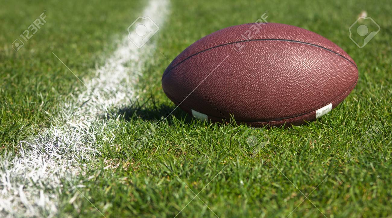 A close up of a American football on grass. Banque d'images - 6119750