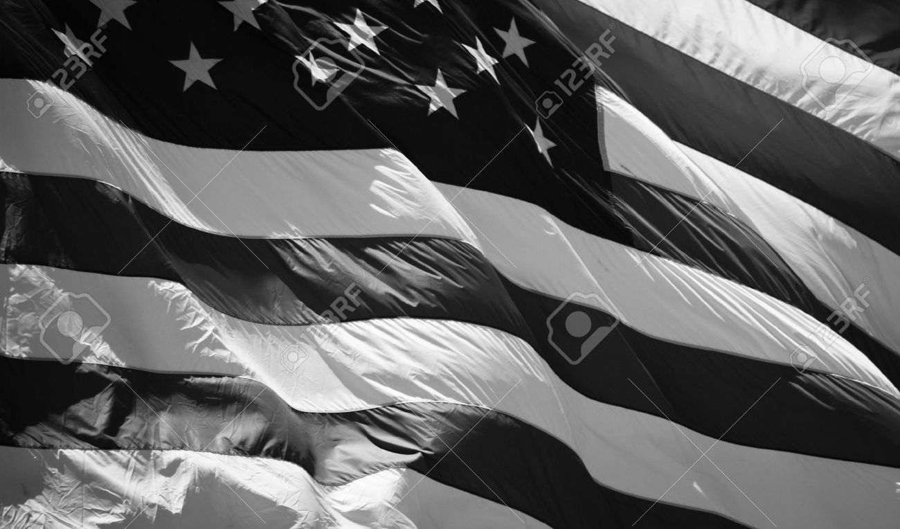 A close up of an American Flag waving in the wind. Banque d'images - 9857315