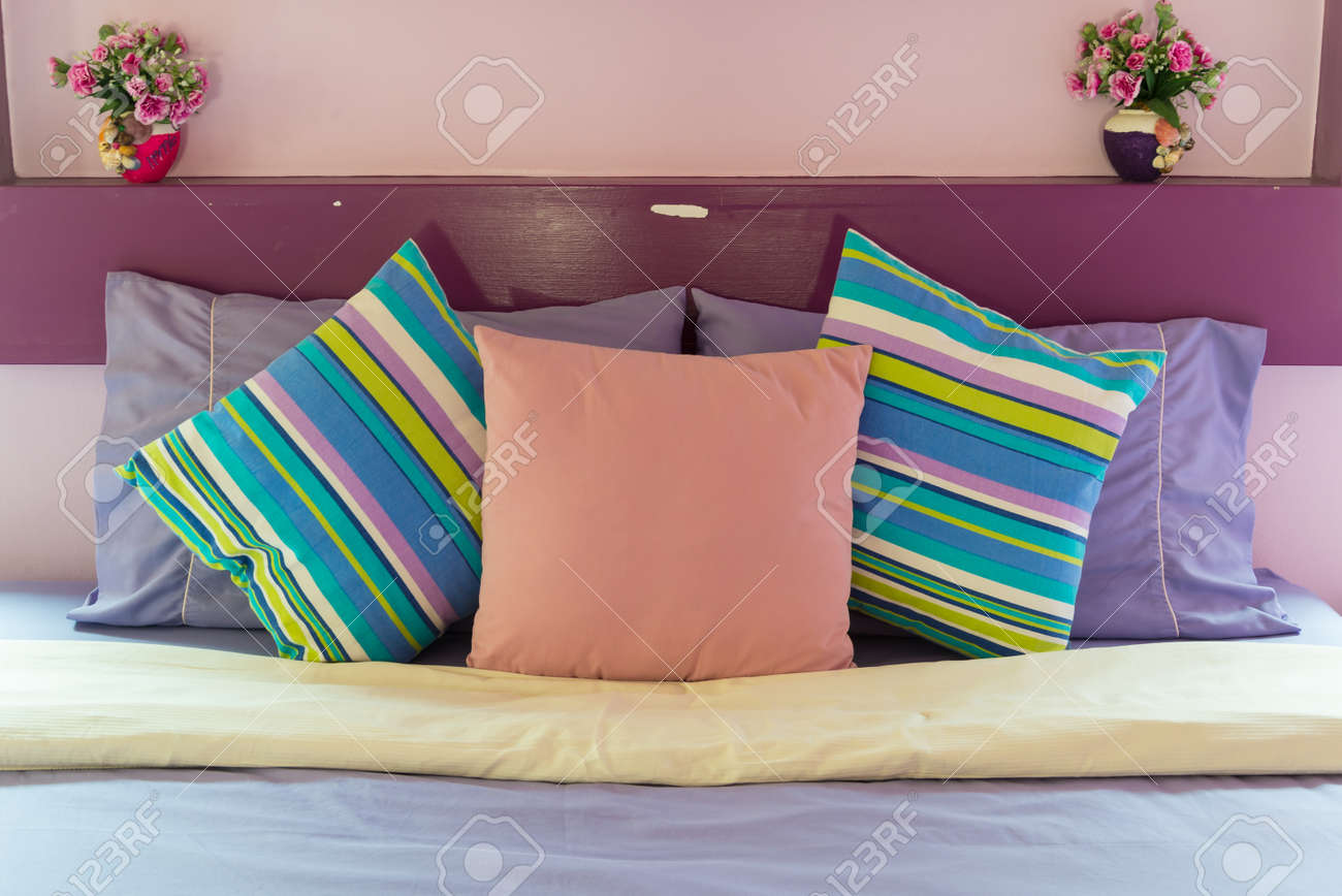 Bedroom style with colorful pillow Standard-Bild - 18671050