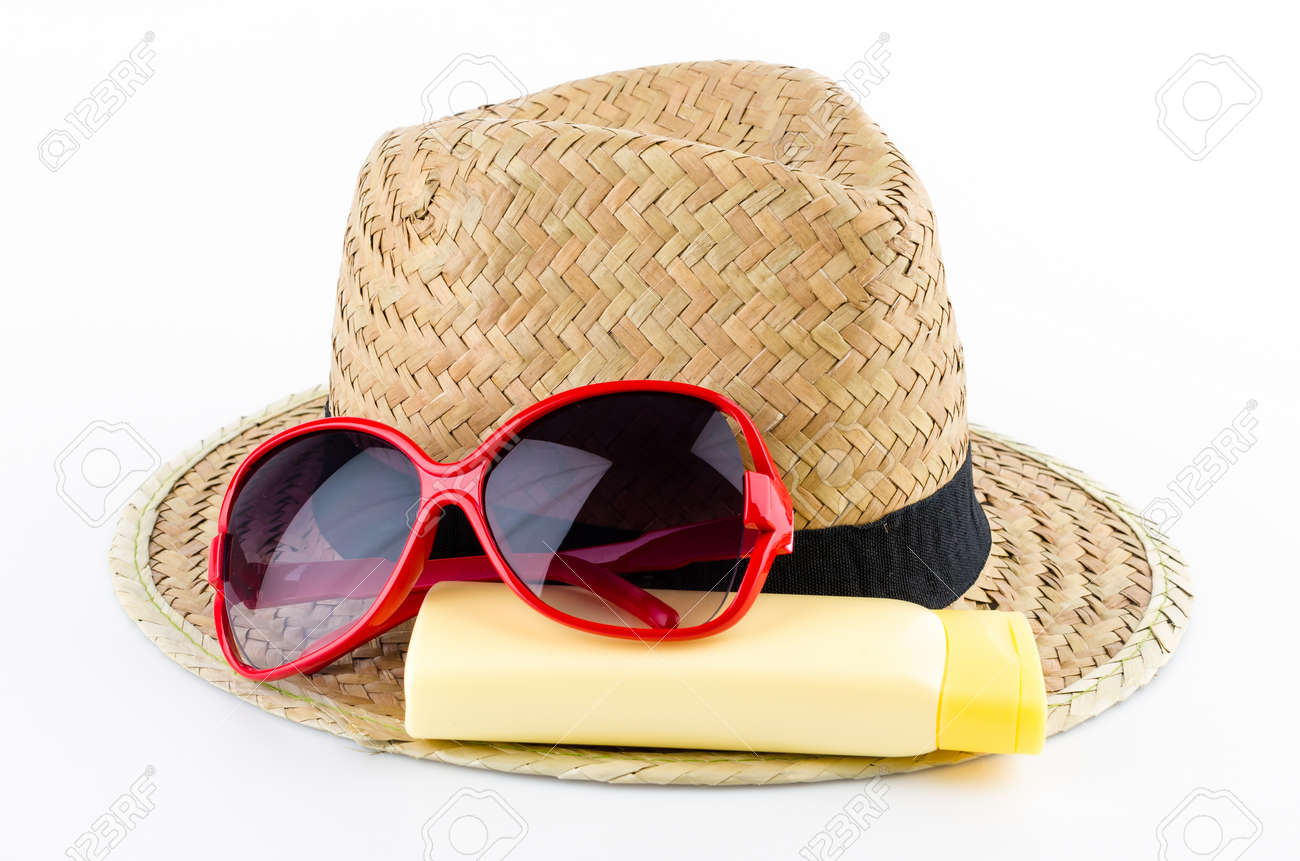 Hat, sunglasses and body lotion isolated on white background Standard-Bild - 24942085