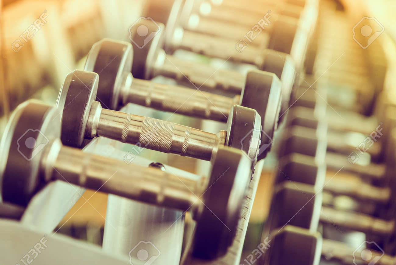 dumbbells in gym - vintage effect and sun flare filter effect Standard-Bild - 37315373