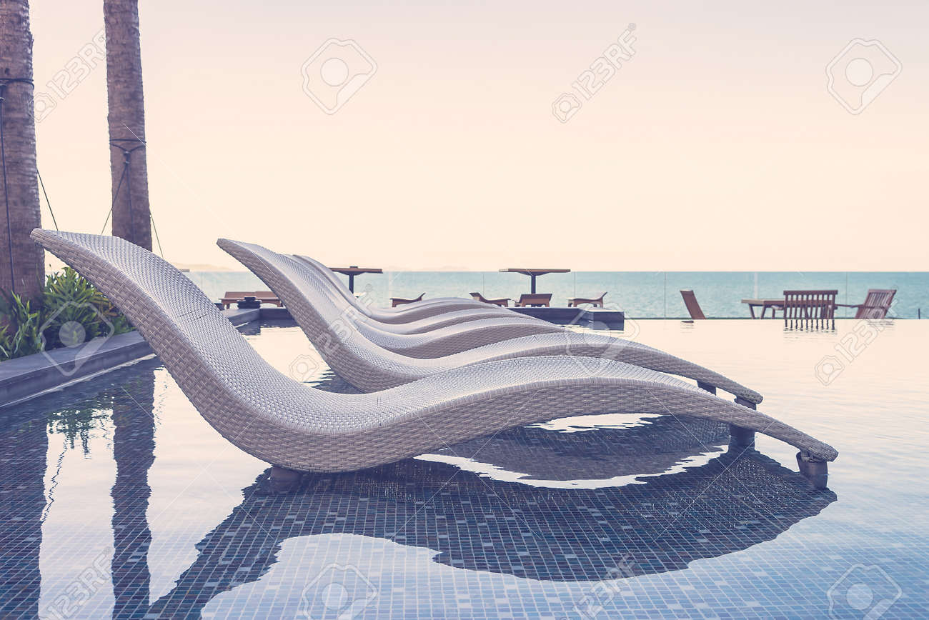 Resort pool with chairs - vintage filter effect Standard-Bild - 41235325