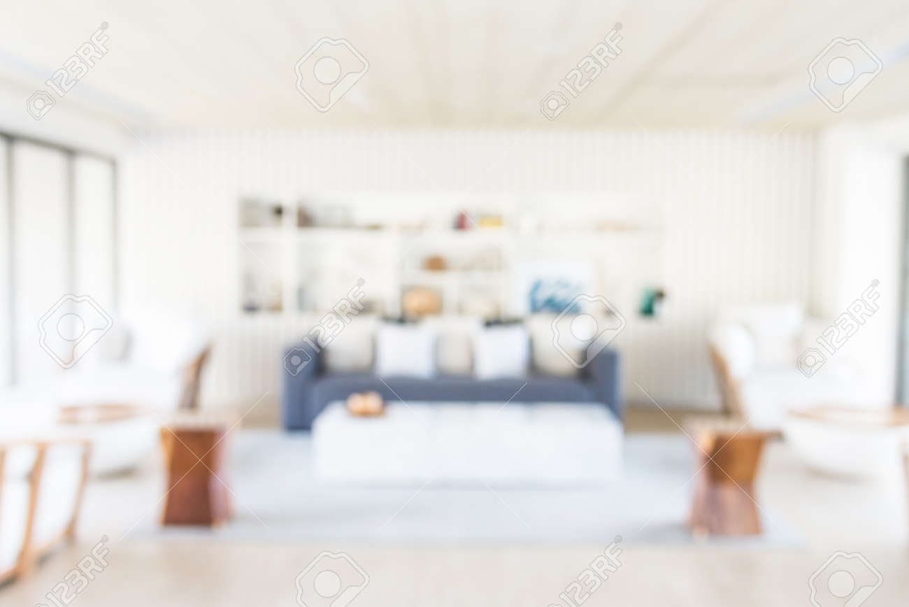 Empty wood table and blurred living room background stock photo - Room Background Abstract Blur Living Room Background
