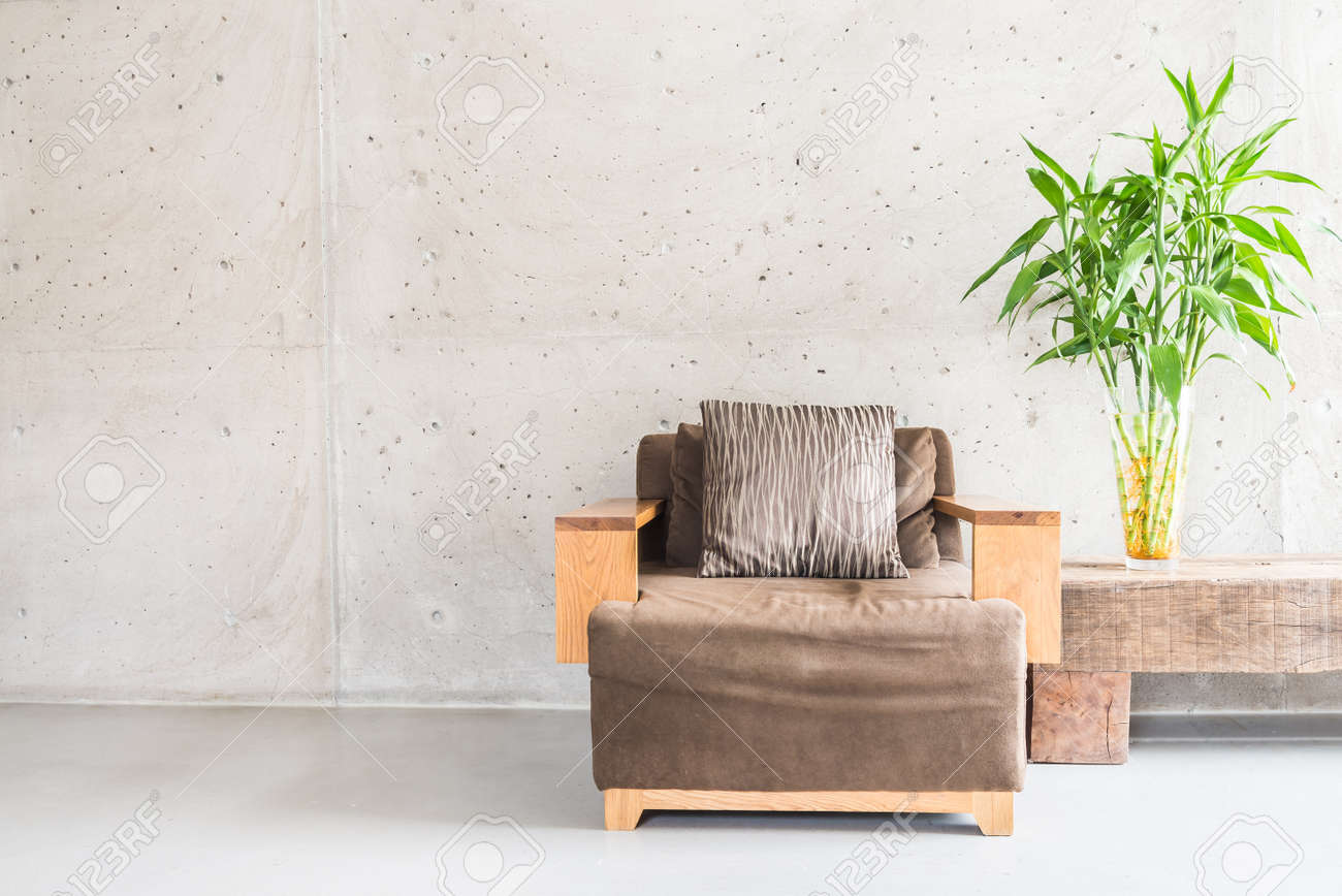 Beautiful Luxury Wooden Sofa Decoration On Empty Wall With Vase