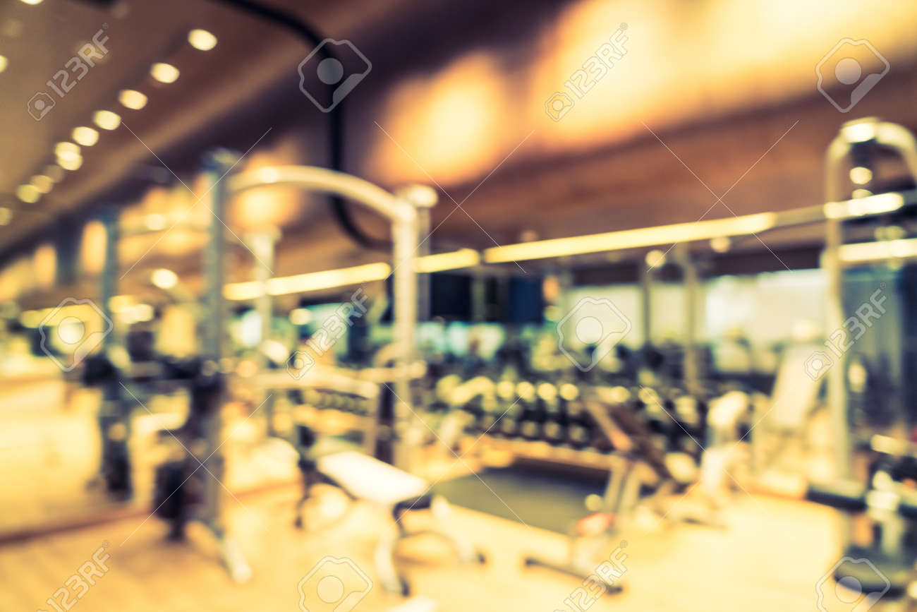 Abstract blur fitness gym room interior background vintage