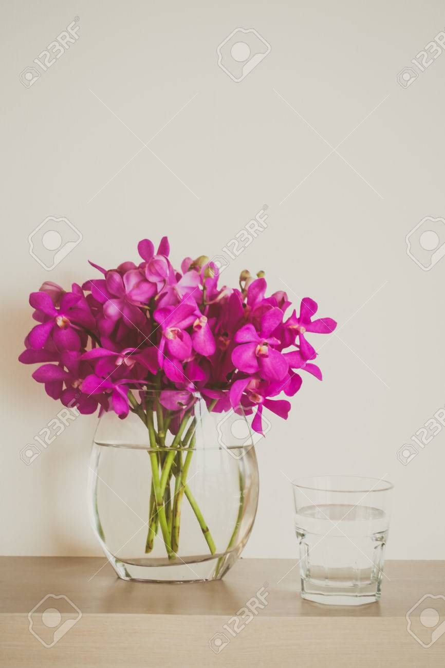 Water glass with orchid flower vase vintage filter stock photo water glass with orchid flower vase vintage filter stock photo 59421824 reviewsmspy