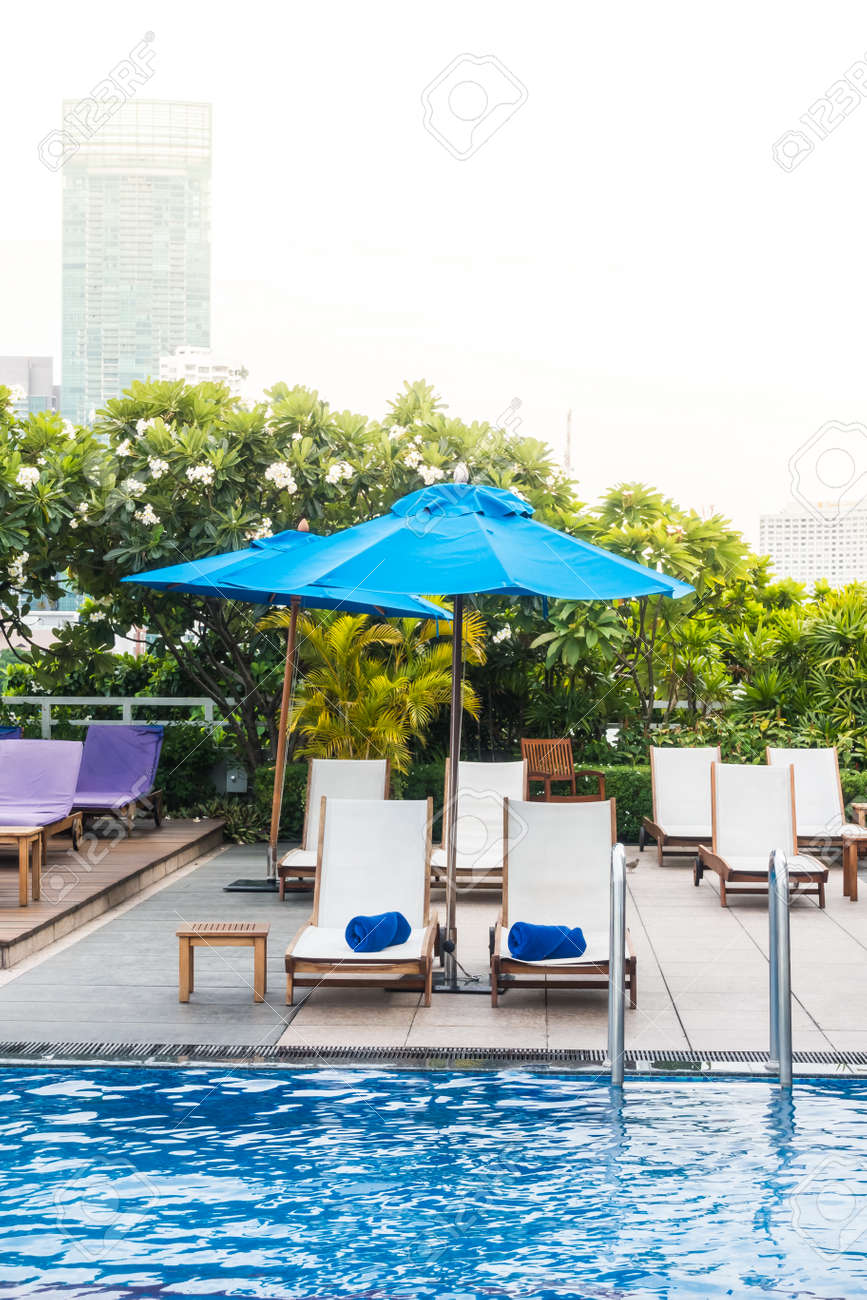 Umbrella And Chair Decoration Around Swimming Pool In Hotel Stock Photo Picture And Royalty Free Image Image 60828373