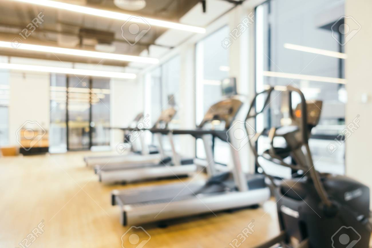 Abstract blur fitness equipment in gym room interior for