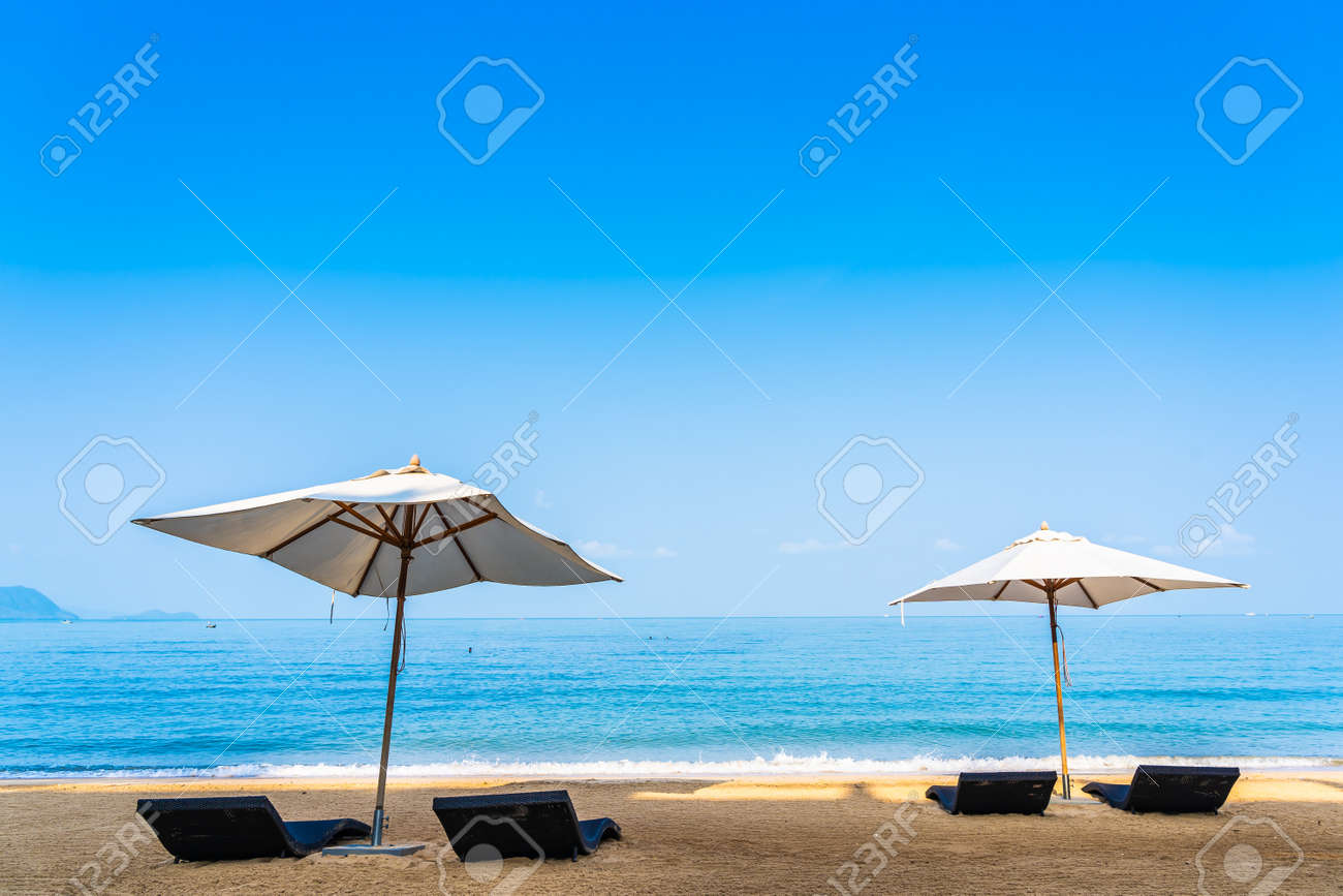 Chair umbrella and lounge on the beautiful beach sea ocean on sky for leisure travel and vacation concept - 121236586