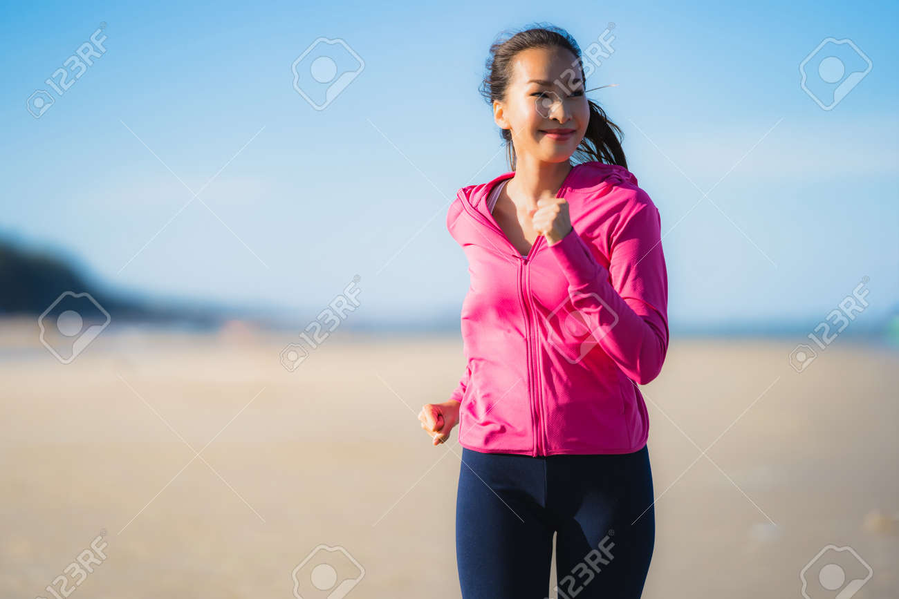 Portrait beautiful young asian woman running or exercise on the tropica nature landscape of beach sea ocean for healthy concept - 122456157
