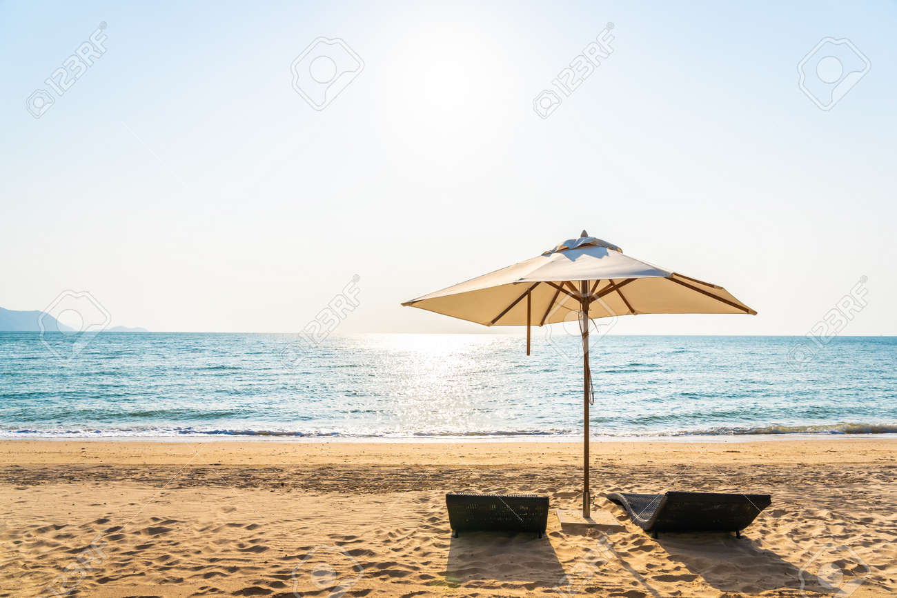 Chair umbrella and lounge on the beautiful beach sea ocean on sky for leisure travel and vacation concept - 123485557