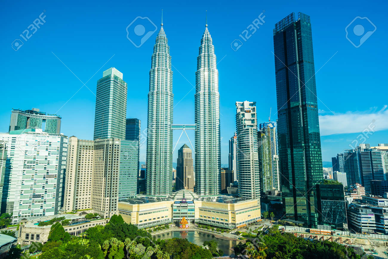 Beautiful architecture building exterior city in kuala lumpur skyline with white cloud and blue sky - 123456206