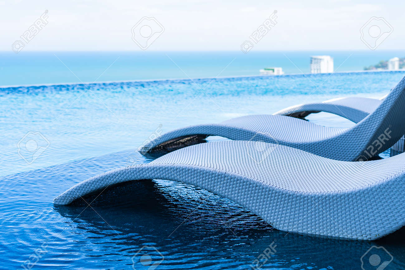 Beautiful outdoor landscape of infinity swimming pool in hotel..