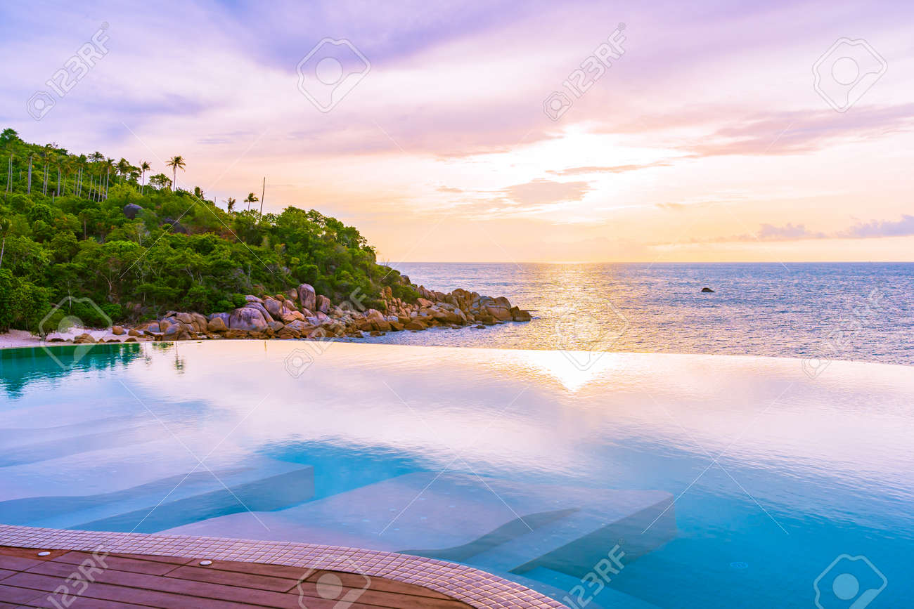 Beautiful outdoor infinity swimming pool with sea ocean view..