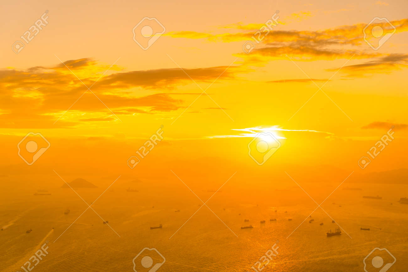 Beautiful colorful sunset in hong kong city skyline with sea and ocean bay - 130227346