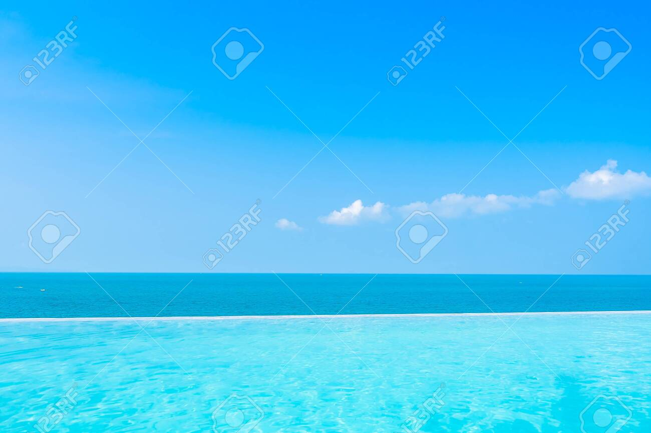 Beautiful landscape of sea ocean with outdoor swimming pool on white cloud blue sky background for leisure travel and vacation - 130418551