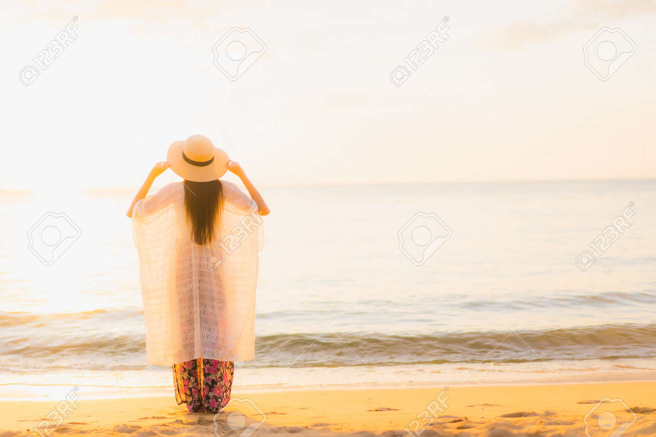 Portrait beautiful young asian women happy smile relax around beach sea ocean at sunset or sunrise time for travel vacation - 135870744