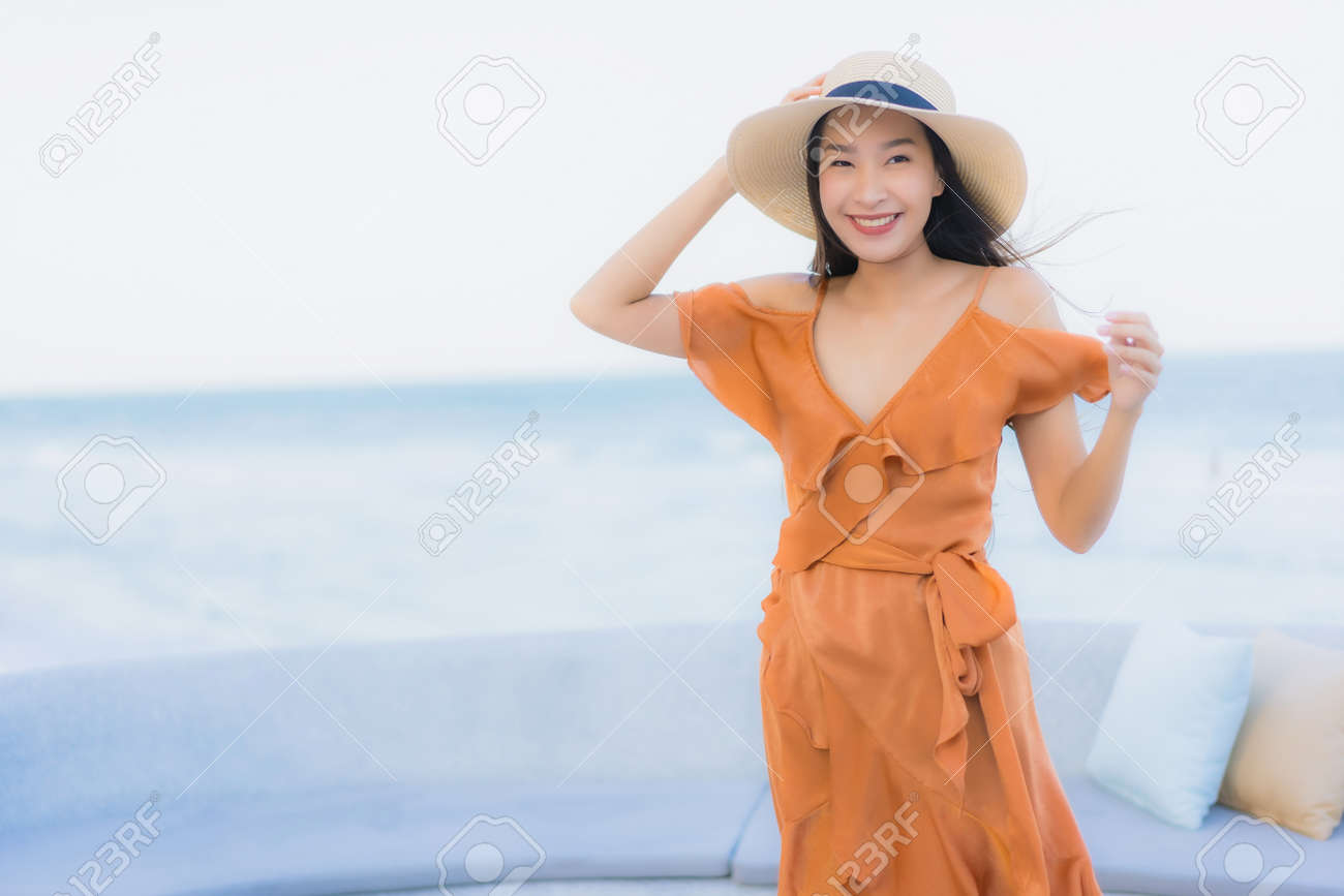 Portrait beautiful young asian woman happy smile around sea ocean beach and blue sky for leisure travel vacation - 142768006