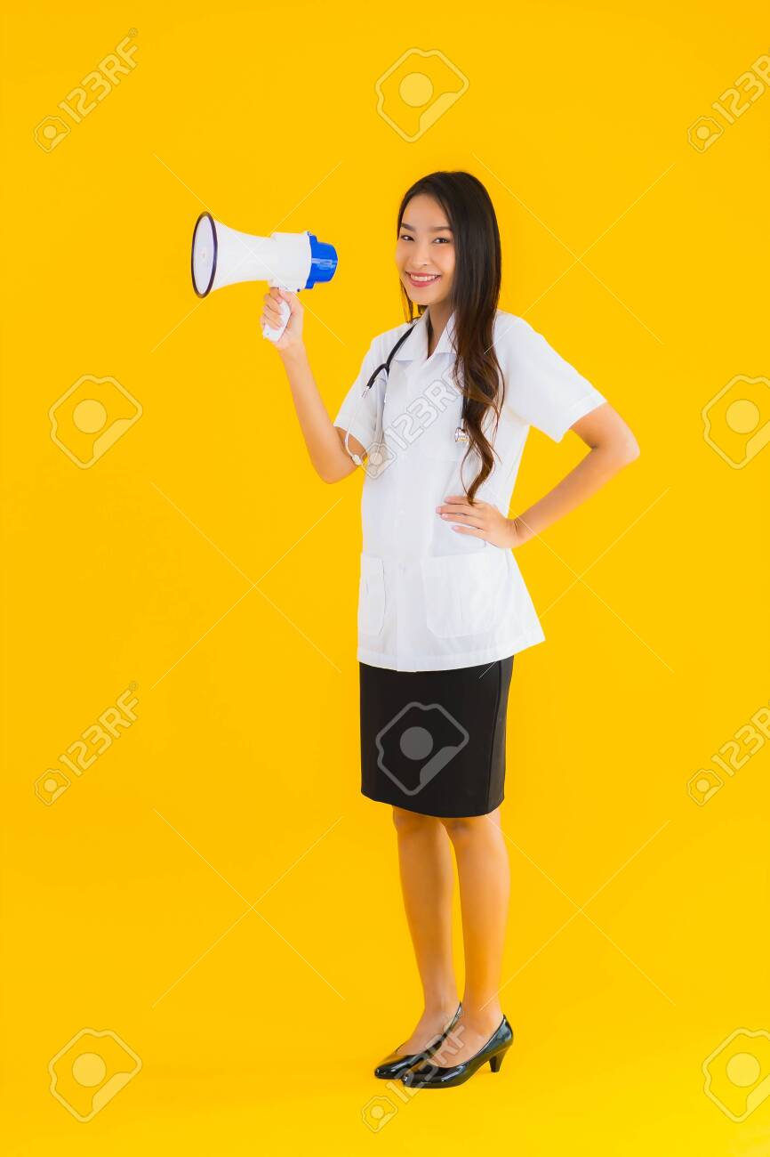 Portrait beautiful young asian doctor woman use megaphone on yellow isolated background - 146752069