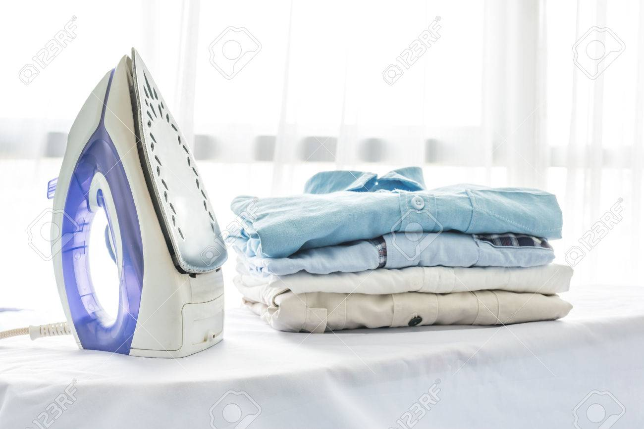 Ironing, Clothes, Housework And Objects Concept, Close Up Of Iron And  Clothes On