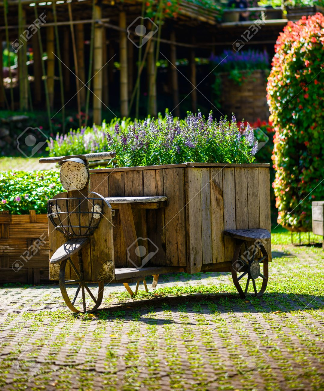 Tricycle Made Of Wood Use For Garden Decor Stock Photo, Picture And ...