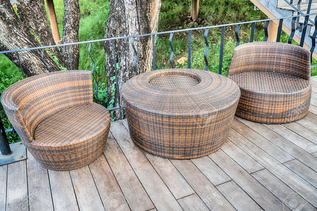 The wood table on natural outdoor of a restaurant with tree and