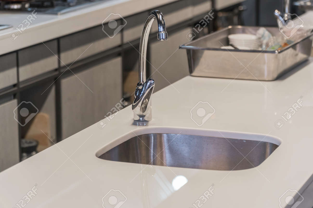 Modern kitchen faucet with LED light.