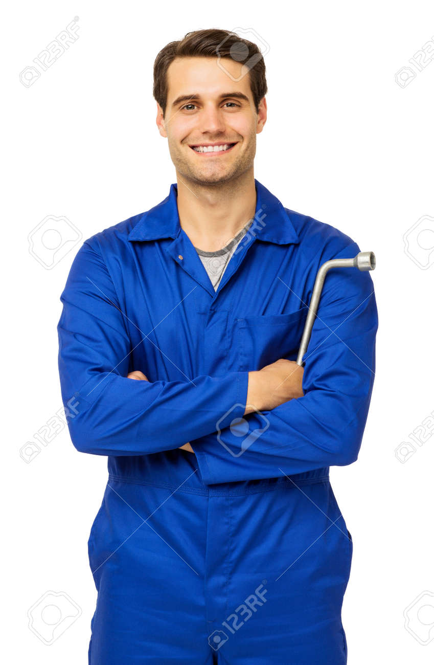 portrait of confident male mechanic standing with arms crossed