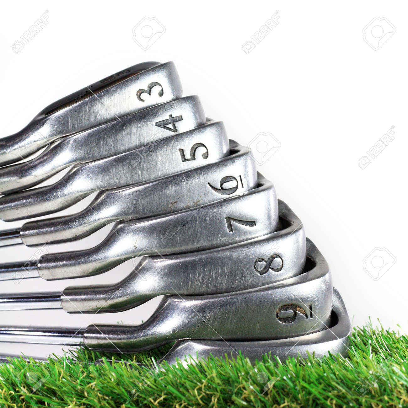 set of golf irons on the green grass Stock Photo - 17536591