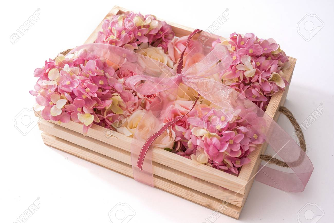 Pink Ribbon And Pink Flowers In Wooden Box Stock Photo Picture And