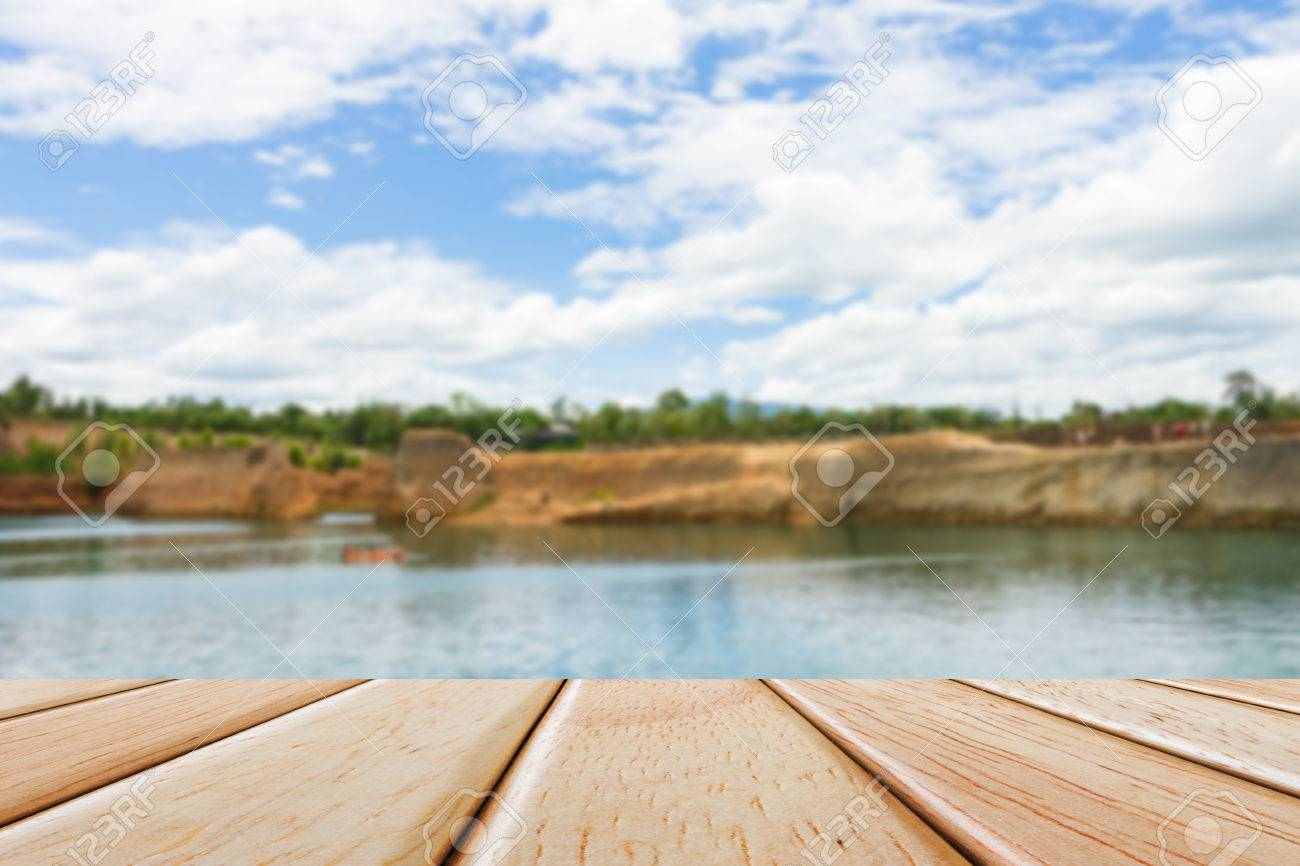 Empty wood table and blurred living room background stock photo - Empty Wooden Deck Table Over Blur Nature Background Stock Photo 47060100