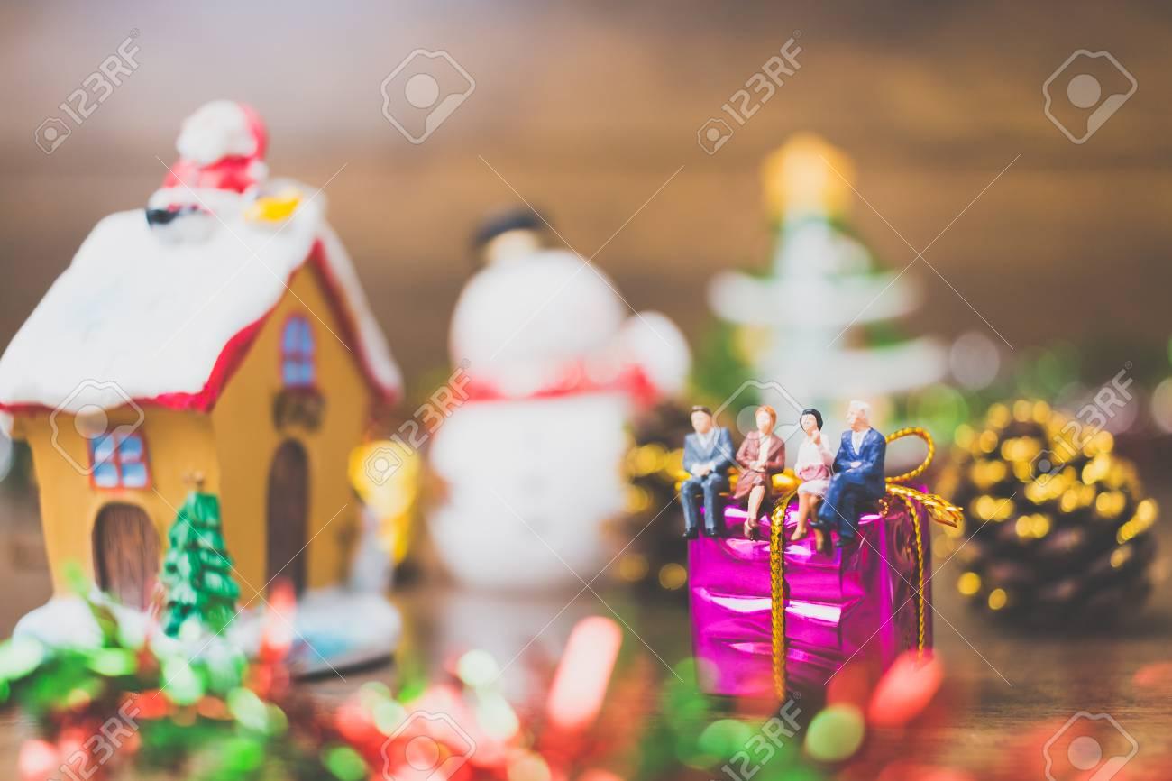 Christmas Day Celebration.Miniature People On Gift Box With Christmas Day Celebration Background