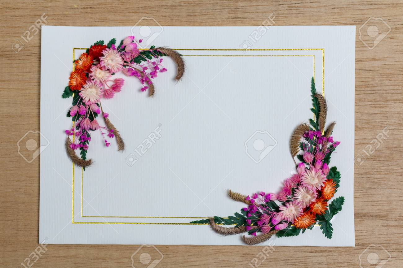 Flat Lay Floral Frame Dried Flowers And Leaves On Paper Stock Photo Picture And Royalty Free Image Image 117384052